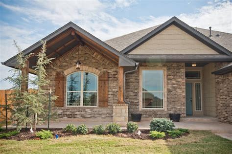 home exterior design brick and stone large front porch with brick and stone accents