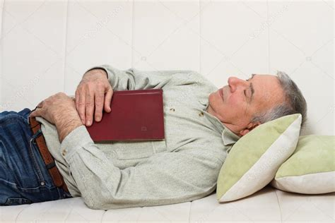 old bed guy old man sleeping with book stock photo 169 inesbazdar