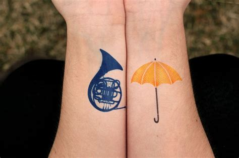 elephant tattoo umbrella yellow umbrella tattoo on forearm