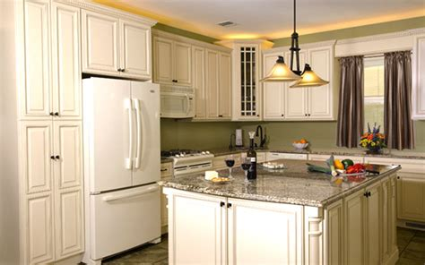 ivory colored kitchen cabinets in stock ivory glaze painted white cabinets beyond