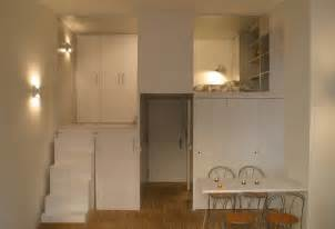Organizing Kitchen Appliances - compact loft in madrid displaying smart storage solutions by beriot bernardini arquitectos
