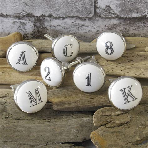 white ceramic alphabet letter and number cupboard drawer