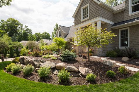 Ideas For Small Bathrooms Makeover front yard with boulder wall and shrub bed traditional