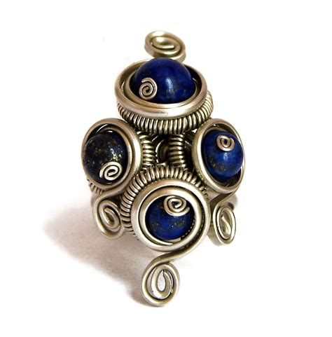 wire wrapped ring with lapis lazuli stones by hyppiechic