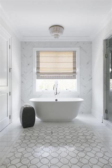 egg shaped tub  black  white oval tile floor