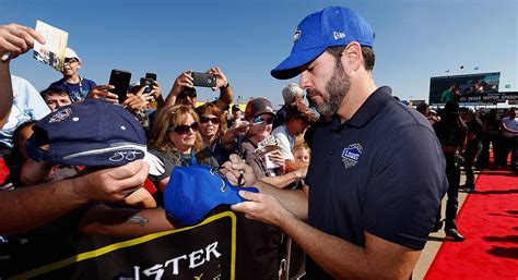 country music video with nascar driver jimmie johnson attends presents country music awards