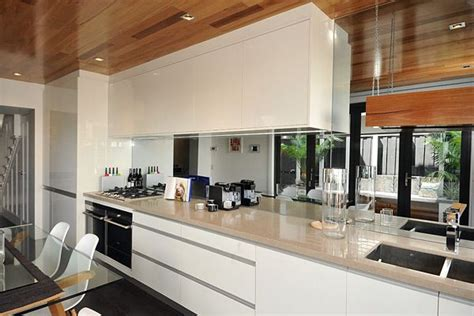 how to make a galley kitchen look larger mirror splashback ideal for a small kitchen feel
