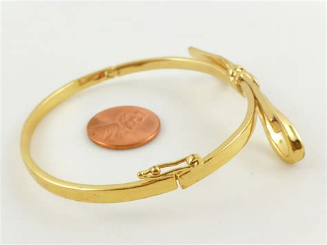 Bow Gemstone Bangle kate spade new york yellow gold plated bow hinged