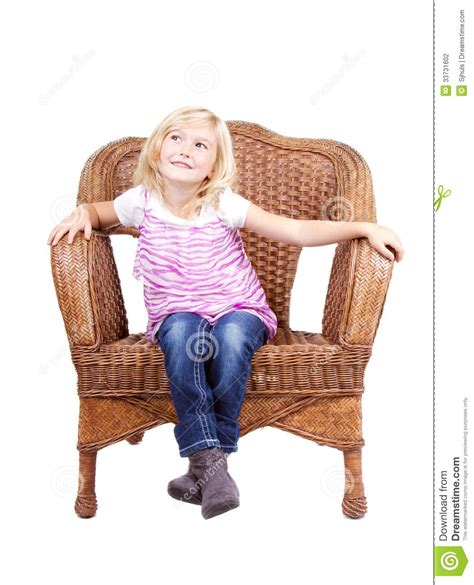 little girl on chair little girl sitting on a chair stock photography image