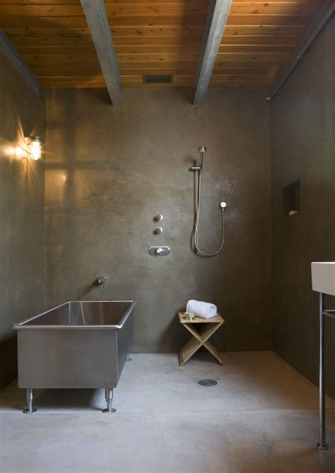polished concrete floor bathroom simple sustainable house metal volume design xeriscaping