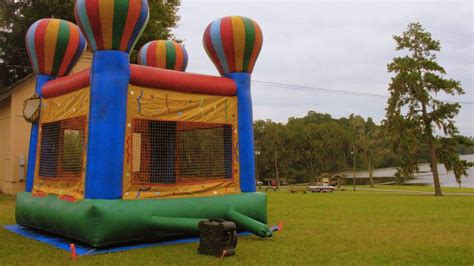 Bounce House Blows Away With Three Children Inside And