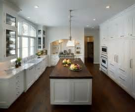 white kitchen island with butcher block top island with butcher block top transitional kitchen kitchen studio of glen ellyn
