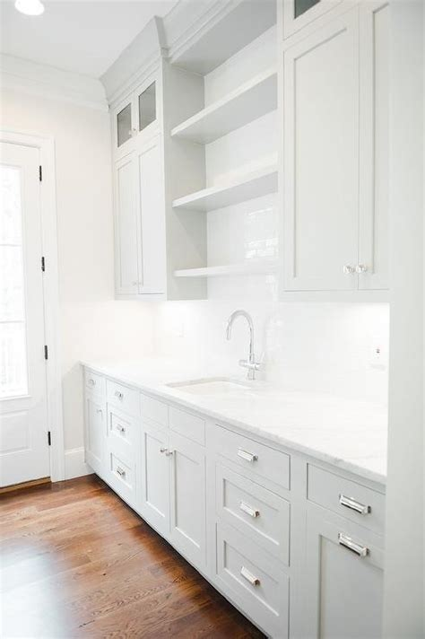 grey butler pantry cabinets  white marble countertops