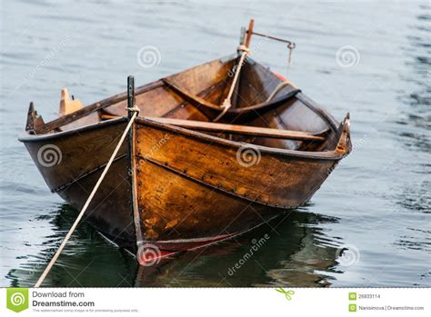 wooden boat images wooden boat on water stock images image 26833114