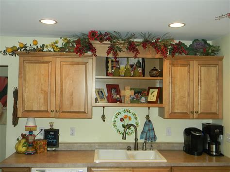 decorate kitchen cabinets decorating above kitchen cabinets before and after