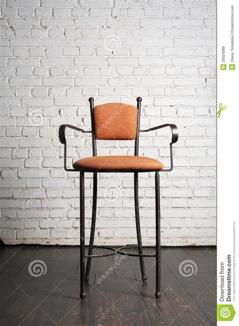 Against A Brick Wall modern stylish chair against a brick wall royalty free