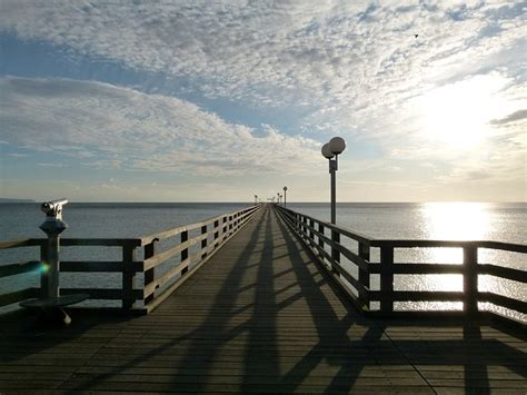 pier in french pier sunset clouds sky france plank dock wood photo free