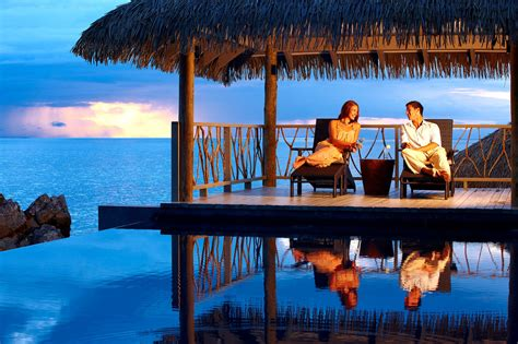 bungalow overwater in fiji islands yfgt couple relaxing on a honeymoon in the bungalow over water