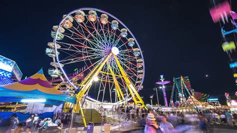 fair swings carnival rides and games at night stock footage video
