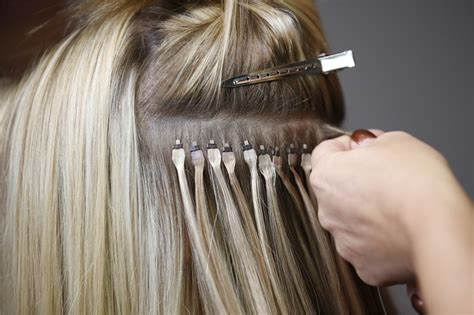 tricks to having a weave that lies flat all about donna bella hair s flat tip hair extensions and
