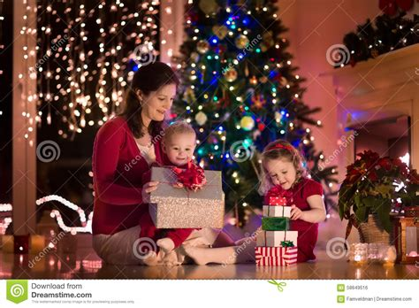 christmas gift opening ideas and children at home on stock photo image of family celebration 58649516
