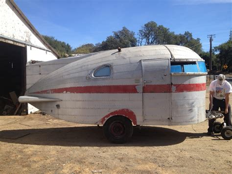 retro teardrop cer for sale going to the moon tin can tourists