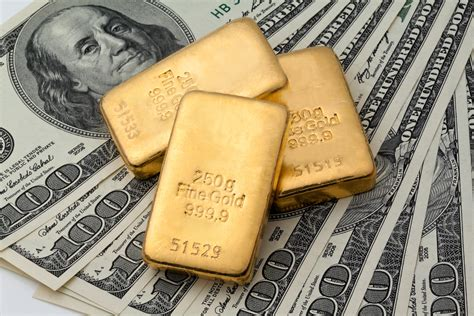 gold dollar gold settles lower as dollar us equities strengthen ifa