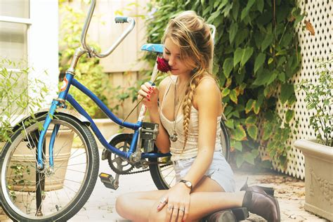 wallpaper girl on bike beautiful girl with bicycle smelling rose wallpaper