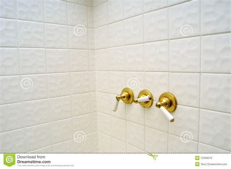 Golden Shower by Three Golden Shower Valve Handles Royalty Free Stock