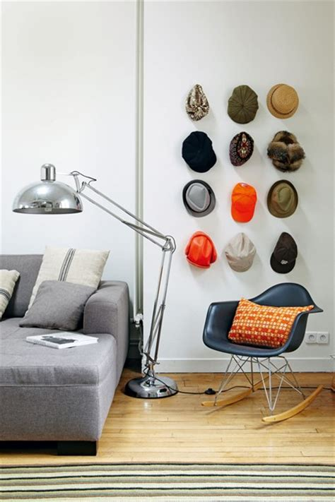hat collection on a wall in the living room home storage