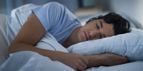 man sleeping in bed if you work shifts this is why you need more sleep the