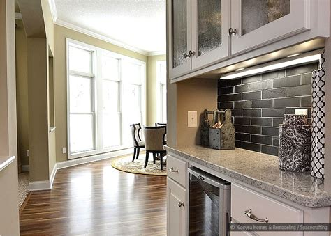black subway tile backsplash black and copper granite dark brown hairs