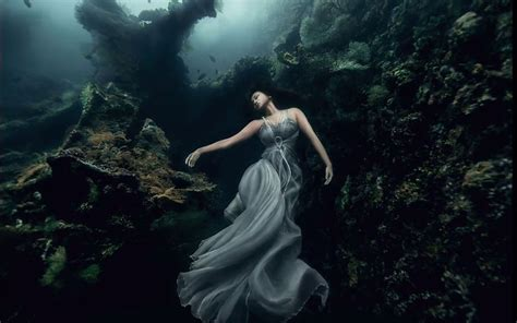 models dive 25 meters to an underwater shipwreck for a
