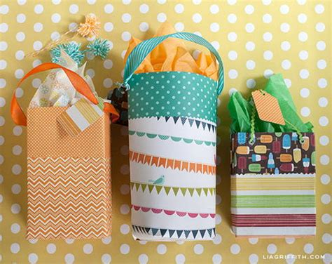 How To Make Paper Goody Bags - scrapbook paper diy gift bags favecrafts