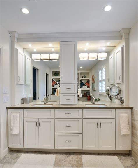 bathroom cabinets with center storage tower