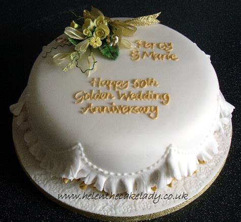 Golden wedding anniversary cake round   delicately frilled