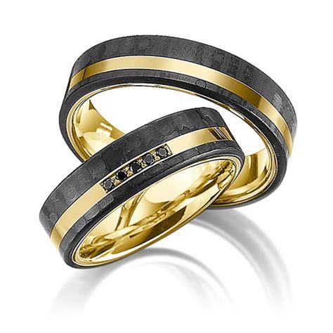 Trauringe Carbon Gold by Trauringe Gelbgold 585 Mit Carbon Einzug Mit 0 05 Ct