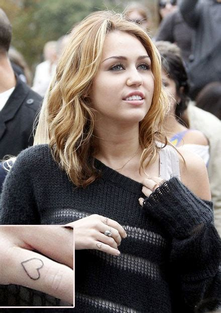 miley tattoos 301 moved permanently