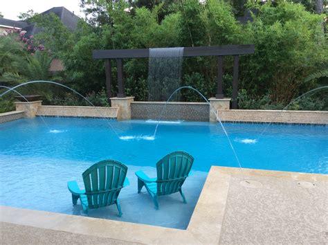 modern geometric pool  tanning ledge deck jets
