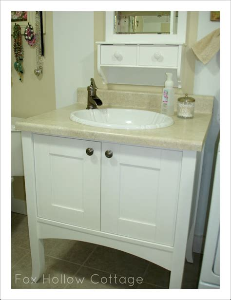 cabinet style water heater before and after a bathroom fox hollow cottage