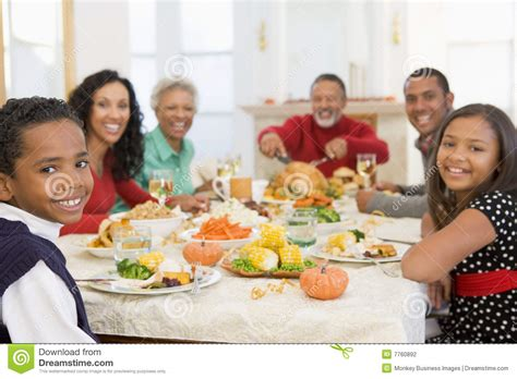 Dripping Kitchen Faucet family all together at christmas dinner stock photography