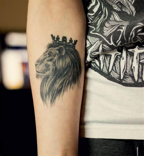 black ink crown on lion head tattoo on left arm lion face tattoo with crown on head tattooimages biz