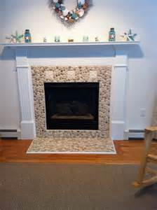 and white pebble tile fireplace surround and hearth