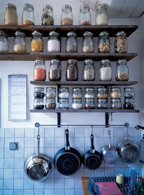 ikea spice rack and mini jars for inside of pantry closet 23 smart ways to use ikea jars at home shelterness