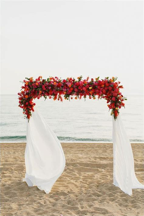 Red floral arch   WeddingElation