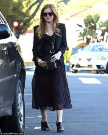 isla fisher looks chic in pleated midi skirt and