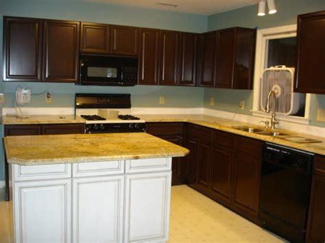 replace or refinish kitchen cabinets oak cabinets painted brown with glaze grain effect