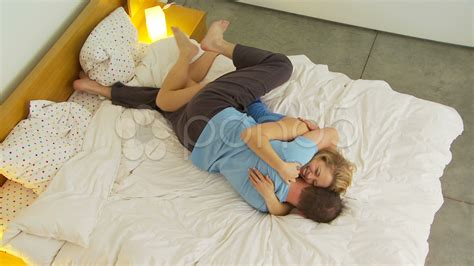 romantic couple in bed images young couple being romantic in bed videos 7729969 hd