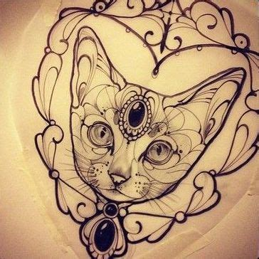 tattoo cat in frame black gem decorated cat portrait in curled frame tattoo