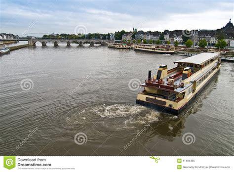 cartoon pleasure boat mooring pleasure boat on the river in maastricht